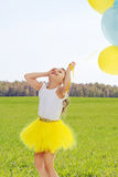 Little girl with balloons in his hands . Royalty Free Stock Image