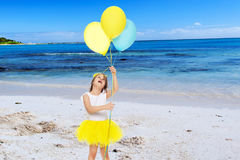 Little girl with balloons in his hands . Stock Photography