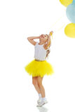 Little girl with balloons in his hands . Royalty Free Stock Photography