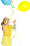 Little girl with balloons. Royalty Free Stock Images