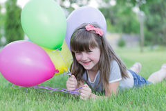 Little girl with balloons, Stock Images