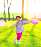 Little girl with balloons outdoors Royalty Free Stock Image