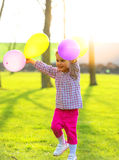 Little girl with balloons outdoors stock photos