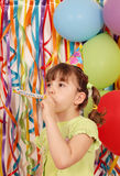 Little girl with balloons and trumpet birthday Stock Images