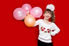 Little girl with balloons on white background royalty free stock photography