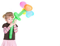 Little girl with baloons flower Stock Image