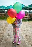 Little girl with baloons in the park Royalty Free Stock Image
