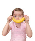 Little girl with banana Royalty Free Stock Image
