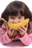Little girl with banana smile Stock Images