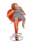 Little girl on bar stool posing - isolated Stock Photos
