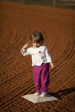 Little girl on basball field Stock Images