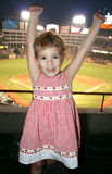 Little Girl at Baseball Game. A little girl jumps for joy at a baseball game Stock Photography