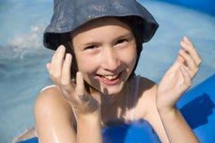 Little girl in basin Royalty Free Stock Photo