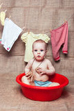 Little girl in a basin Royalty Free Stock Photography