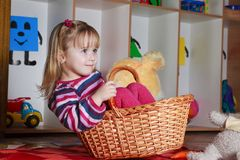 Little girl with basket Royalty Free Stock Photo