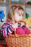 Little girl with basket. Playing Royalty Free Stock Photography