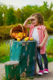 Little girl with a basket of apples Royalty Free Stock Image