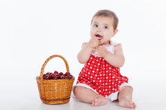 Little girl with a basket of cherries berries stock photo