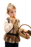 Little girl with a basket and Christmas cookies. Stock Photo