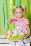 Little girl with basket with Easter eggs Royalty Free Stock Image