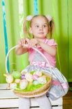 Little girl with basket with Easter eggs Royalty Free Stock Photos