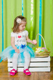 Little girl with basket with Easter eggs Royalty Free Stock Images
