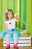 Little girl with a basket with Easter eggs Stock Photo