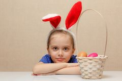 Little girl with basket Easter eggs stock photo