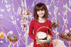 Little girl with basket eggs Easter bunny smile Stock Images