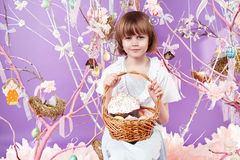 Little girl with basket eggs Easter bunny smile Stock Photos