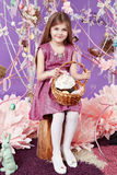 Little girl with basket eggs Easter bunny smile Stock Photography