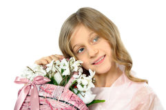 Little girl with basket of flowers Royalty Free Stock Image