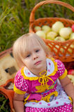 Little girl with basket of fresh apples Royalty Free Stock Images