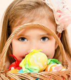 Little girl with basket full of colorful easter eggs Royalty Free Stock Images