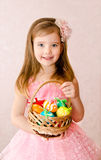 Little girl with basket full of colorful easter eggs Royalty Free Stock Photos