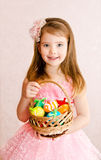 Little girl with basket full of colorful easter eggs Royalty Free Stock Photography