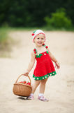 Little girl with basket full of strawberries Royalty Free Stock Image