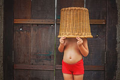 Little girl with basket on her head. Cute and funny little girl with basket on her head Royalty Free Stock Photo