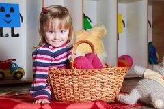 Little girl with basket playing Stock Photography