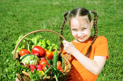 little girl with basket of vegetables Stock Photos