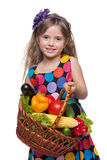 Little girl with a basket of vegetables Royalty Free Stock Photography