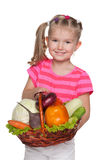 Little girl with a basket with vegetables Royalty Free Stock Image