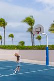 Little girl with basketball on court at tropical Royalty Free Stock Photo