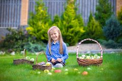 Little girl with baskets full of tomatoes Royalty Free Stock Photos