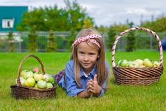 Little girl with baskets full of tomatoes Stock Photos