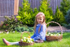 Little girl with baskets full of tomatoes Royalty Free Stock Images