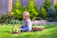 Little girl with baskets full of tomatoes Stock Photo