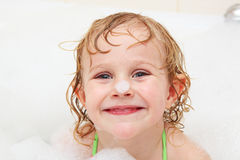 Little girl in bath Stock Photos
