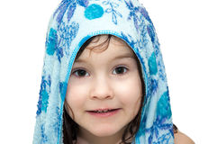 Little girl after bath, on her head lies towel, smiling, portrait royalty free stock image