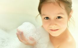 Little girl in bath. At home Stock Photos